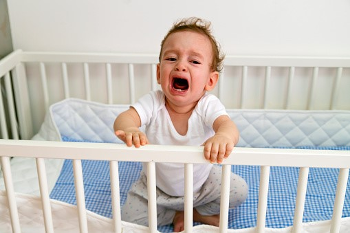 How to get one year old to sleep in a crib