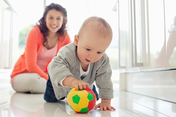 baby is playing with ball