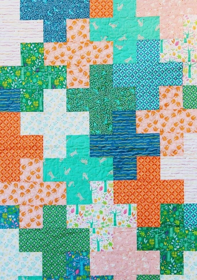 Repeated shape patterns Baby Quilt