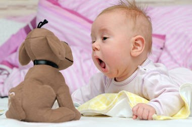 baby playing with dolls